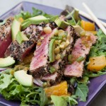 SESAME-CRUSTED SEARED TUNA OVER SALAD GREENS