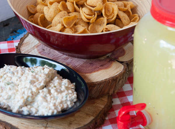 My most requested recipe is an easy dip to prepare.  It combines Mexicali Corn, green onions, cilantro, Cheddar cheese, cumin, mayo and sour cream for an awesome dip that is best served with Frito Scoops.