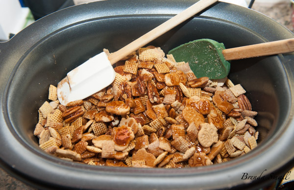 Carefully toss the butter mixture that has been thoroughly whisked together into the snack mix.